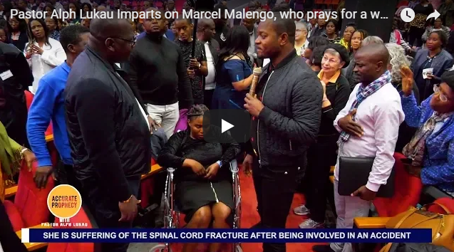 Pastor Alph Lukau Imparts on Marcel Malengo, who prays for a woman on a wheelchair