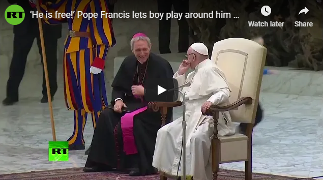 'He is free!' Pope Francis lets boy play around him during his general audience