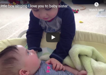 Little boy singing I love you to baby sister