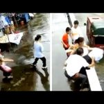 Quick-thinking mother saves daughter from falling off building in Central China